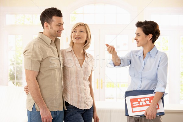Estate agent and couple in new house Stock photo © nyul