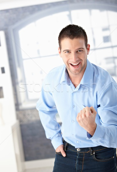 成功した 男 祝う 若い男 こぶし 笑みを浮かべて ストックフォト © nyul