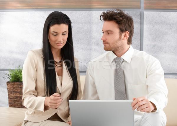 Jovem colegas trabalhando laptop elegante escritório Foto stock © nyul