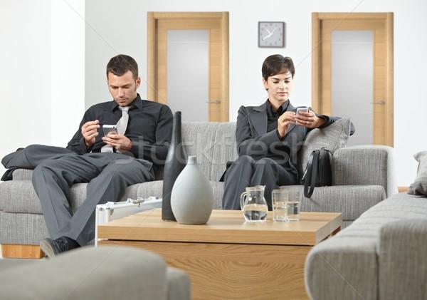 Ludzi biznesu czeka posiedzenia sofa biuro działalności Zdjęcia stock © nyul