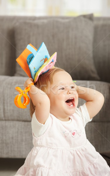 Laughing babygirl with toy Stock photo © nyul