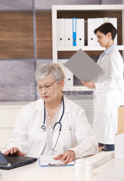 Stock photo: Two doctors working together