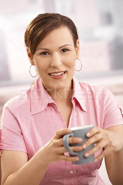 Mid-adult woman drinking coffee Stock photo © nyul