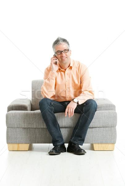 Foto stock: Homem · falante · telefone · móvel · casual · jeans