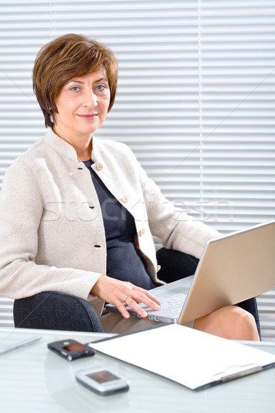 Senior businesswoman with computer Stock photo © nyul