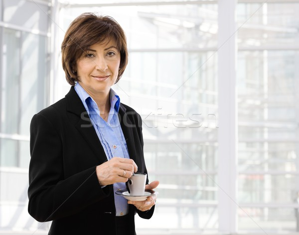 Senior businesswoman drinking coffe Stock photo © nyul