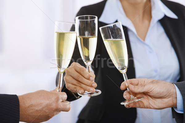 Business people raising toast with champagne Stock photo © nyul