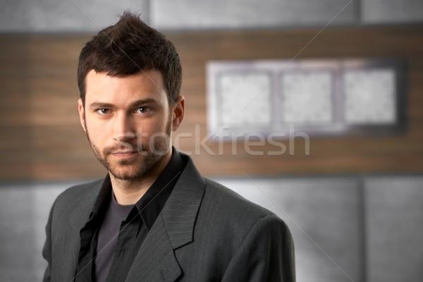 Trendi férfi portré fiatalember néz kamera Stock fotó © nyul