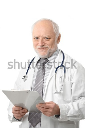 Stock photo: Senior doctor holding papers smiling
