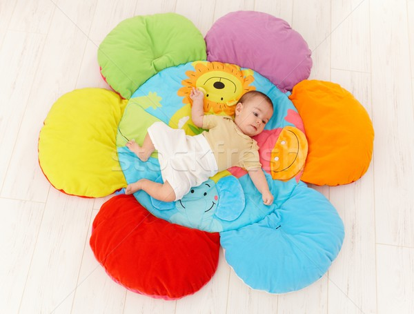 Baby on flower playmat Stock photo © nyul