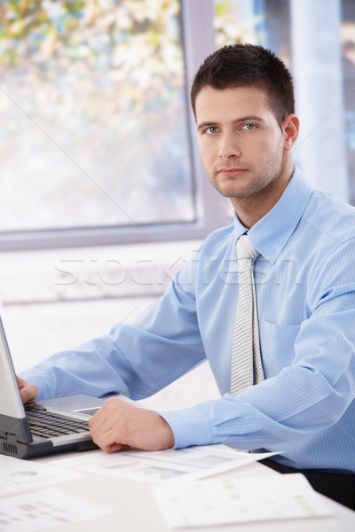 Young businessman sitting in bright office Stock photo © nyul