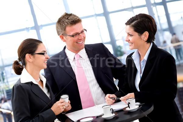 Negócio discussão pessoas de negócios reunião mesa de café sorridente Foto stock © nyul