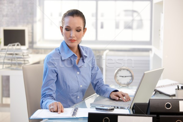Businesswoman concentrating on work Stock photo © nyul