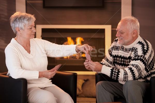 Senior couple playing cards on winter night Stock photo © nyul