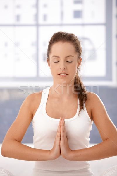 Young woman practicing yoga prayer pose Stock photo © nyul