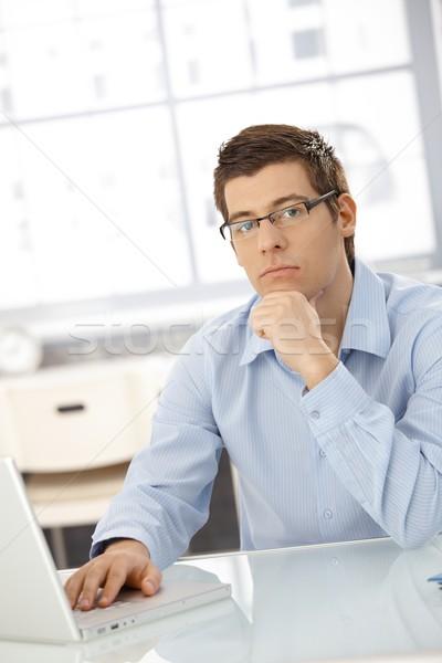 Portrait of thinking businessman Stock photo © nyul