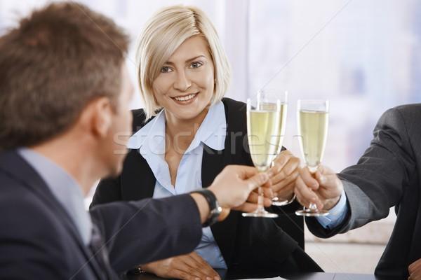 Stockfoto: Zakenvrouw · toast · champagne · gelukkig · jonge · vieren