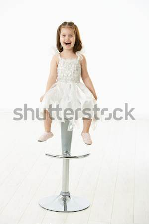 Happy little girl sitting on chair Stock photo © nyul