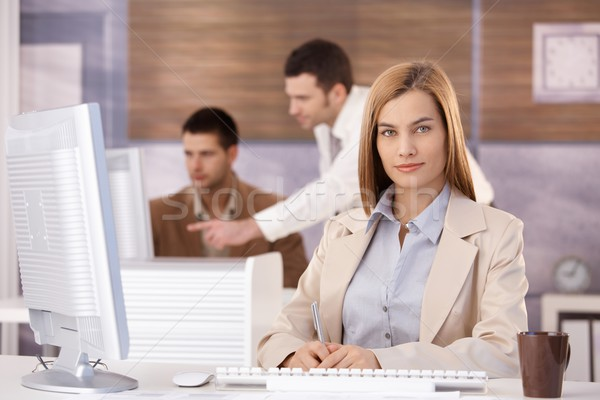 Pretty businesswoman at training course smiling Stock photo © nyul