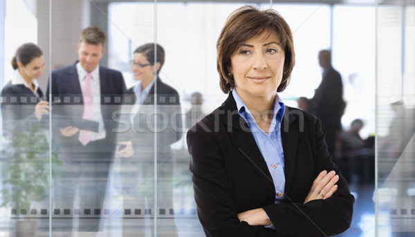 Сток-фото: старший · деловая · женщина · служба · Постоянный · корпоративного