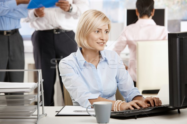 Stock photo: Young businesswoman in office