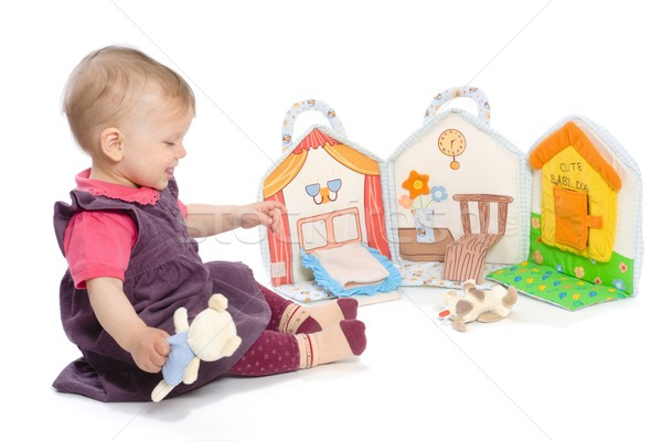 Baby girl with toy book Stock photo © nyul