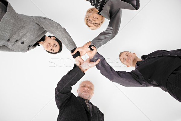 Businessteam holding hands in unity Stock photo © nyul
