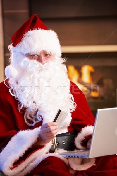 Stockfoto: Kerstman · betalen · creditcard · christmas · presenteert