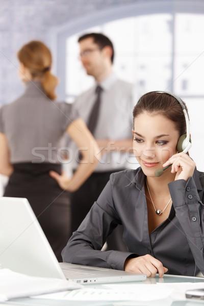 Attractive dispatcher talking on headphones Stock photo © nyul