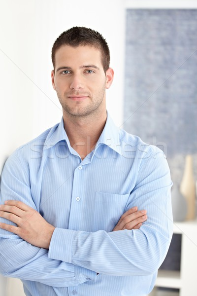 Casual man standing arms crossed smiling Stock photo © nyul