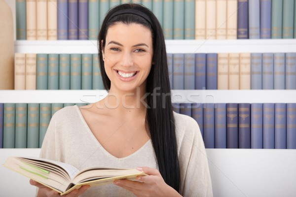 Laughing woman with book Stock photo © nyul