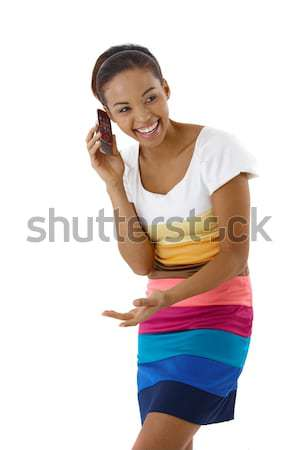 Laughing pretty girl on phone call Stock photo © nyul