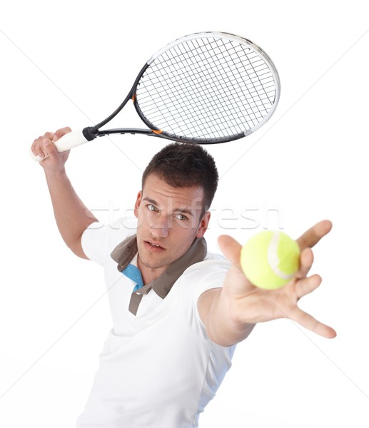 Stock photo: Handsome tennis player serving