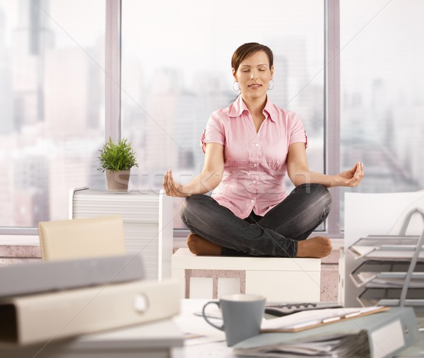 Stock photo: Relaxed office worker doing yoga