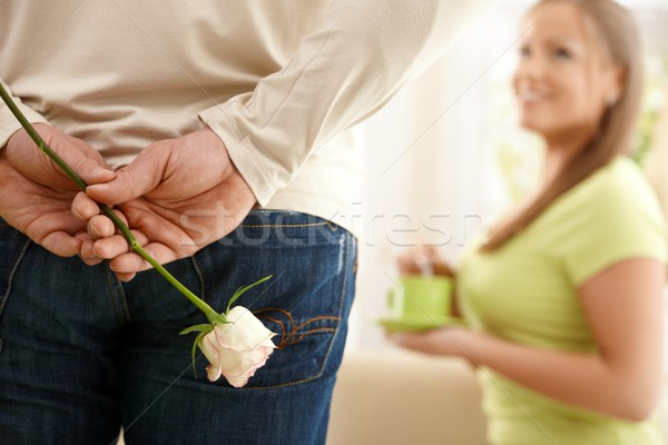 Man surprising woman with flower Stock photo © nyul