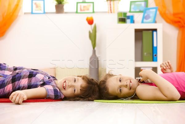 Portrait of young girls enjoying music Stock photo © nyul