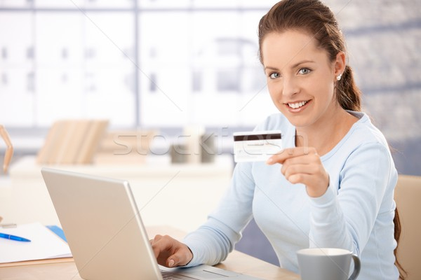 Stock photo: Pretty girl shopping on internet smiling