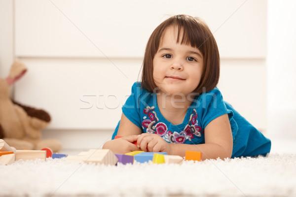 Cute девочку портрет играет полу улыбаясь Сток-фото © nyul