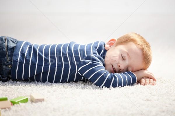 3 year old falling asleep on floor at home Stock photo © nyul