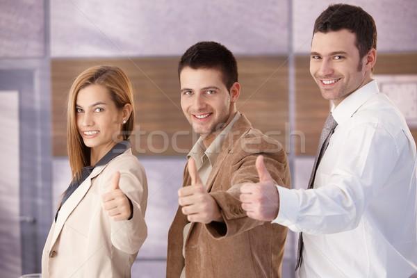 Bem sucedido sorridente jovem alegremente Foto stock © nyul