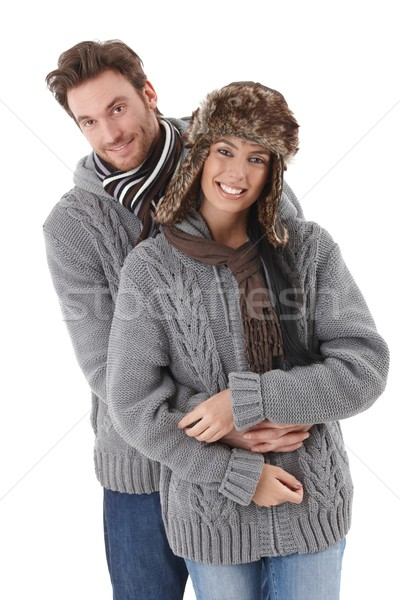 Young couple wearing the same sweater smiling Stock photo © nyul