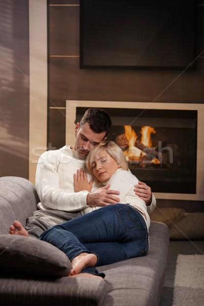 пару домой диван камин Сток-фото © nyul