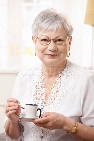 Senior woman drinking coffee at home Stock photo © nyul