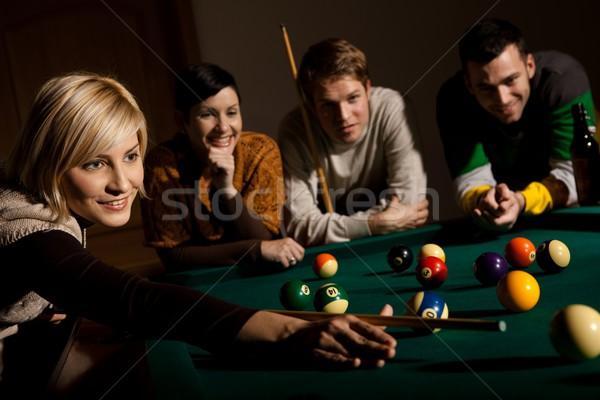 Mosolygó nő játszik snooker fehér labda dől Stock fotó © nyul