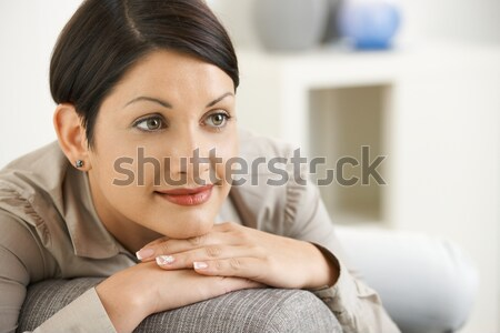 Attractive woman resting on sofa at home Stock photo © nyul