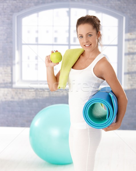 Stock photo: Attractive female having apple after workout