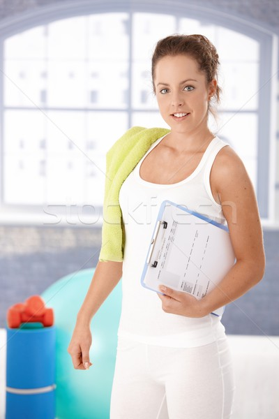 Stock photo: Pretty girl prepared for workout in gym