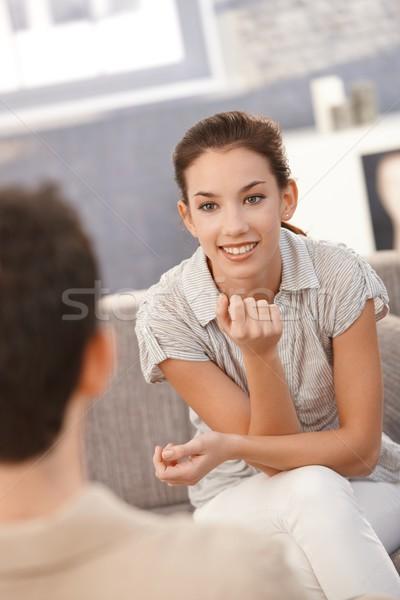 Retrato mulher jovem olhando homem alegremente sessão Foto stock © nyul