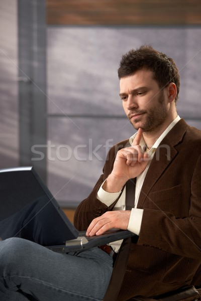Troubled man with laptop Stock photo © nyul