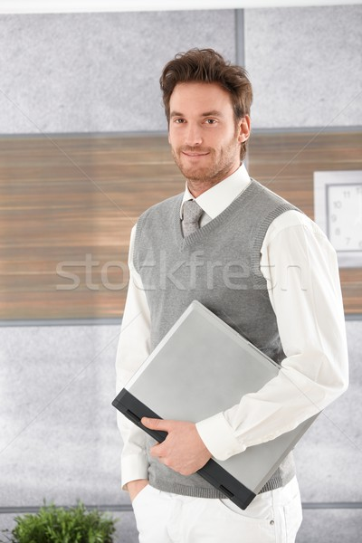Casual man with laptop smiling Stock photo © nyul